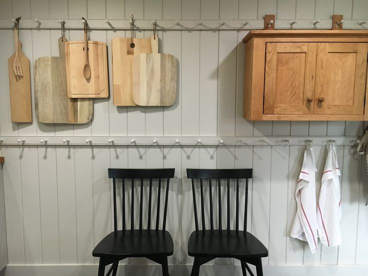 Shaker style peg racks in a guest home kitchen.  Stone House Revival - Season One.