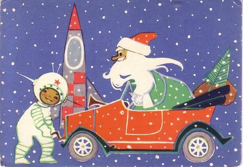 A New Year postcard from year 1965 with Santa and astronaut
