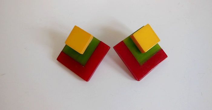 bakelite earrings / Tri Color Vintage 40's Bakelite 1940s Earrings by Planetclairevintage on Etsy https://www.etsy.com/listing/241377027/bakelite-earrings-tri-color-vintage-40s