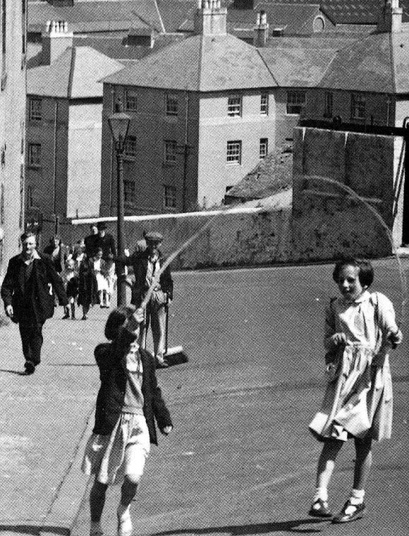 Old photograph (circa 1950's) of children playing safely in streets of Glasgow, Scotland. Changed days!