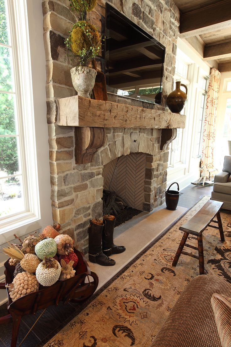Sophisticated Casual Home in Cleveland, OH by W Design rustic fireplace  with stone and heavy mantel.