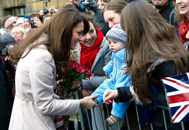 Baby Love...The Duchess met James William Davies, 5 months, in Market Square while visiting Guildhall in Cambridge, England in Nov. 28.