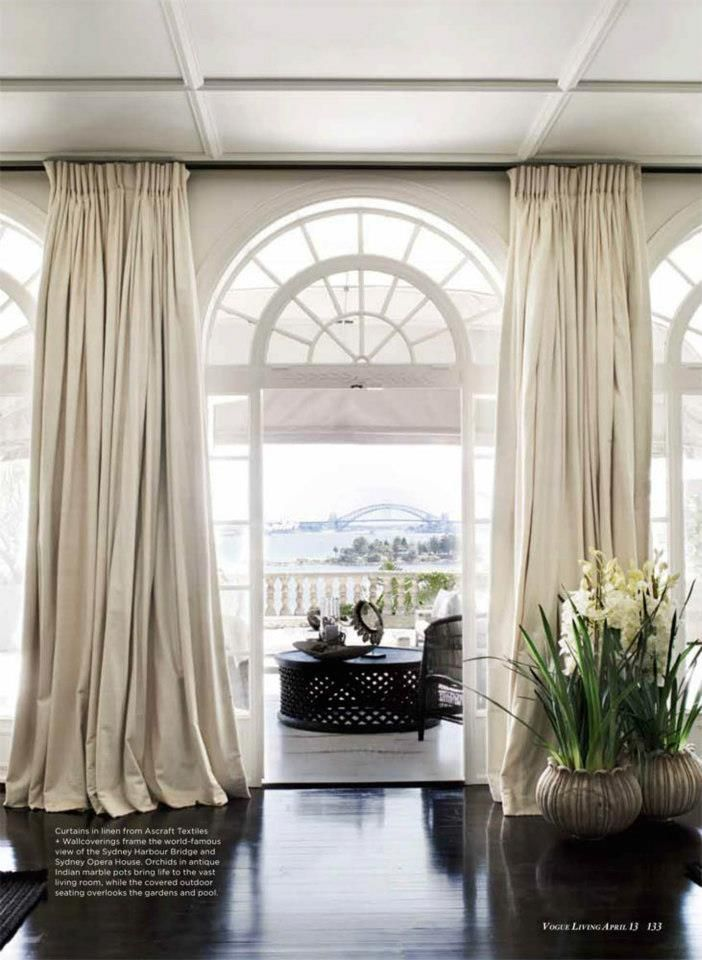 Puddled drapes and gorgeous windows with view photo by for Curtains floor to ceiling windows