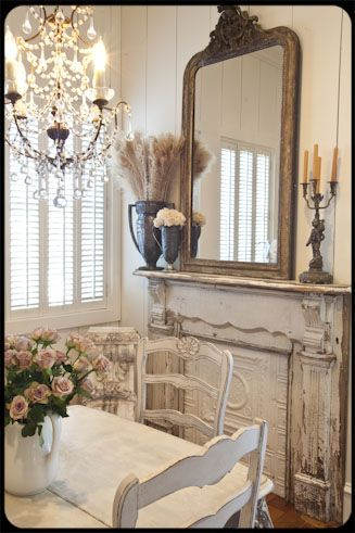 <3 antique trophies as vases ... <3 mirror...chandelier