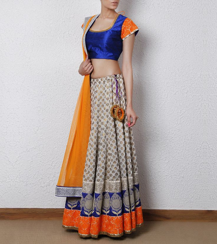 Not loving the sleeves on the top, but the lengha and colors are beautiful