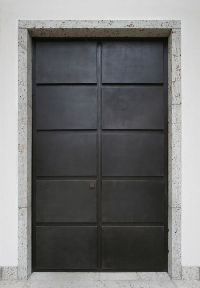 Classical double door in bronze and stone by Germand architect A. Vogel. Timeless.