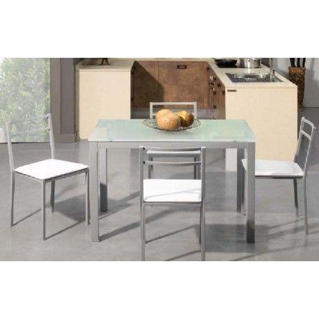 Es un conjunto de mesa con estructura metálica con recubrimiento epoxi-poliester y tapa de cristal templado translúcido negro y naranja de 6,5 mm con cuatro sillas metálicas tapizadas.