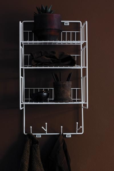 Triple shelf is made from recycled metal wire. Use it in your kitchen, bathroom or hallway. It goes pretty much anywhere due to its sleek and timeless design. Best thing is it has both shelves and hooks.