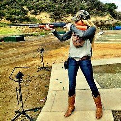 Country girl in blue jeans with gun. Girls with blue jeans also use GunRightsAttorneys.Com