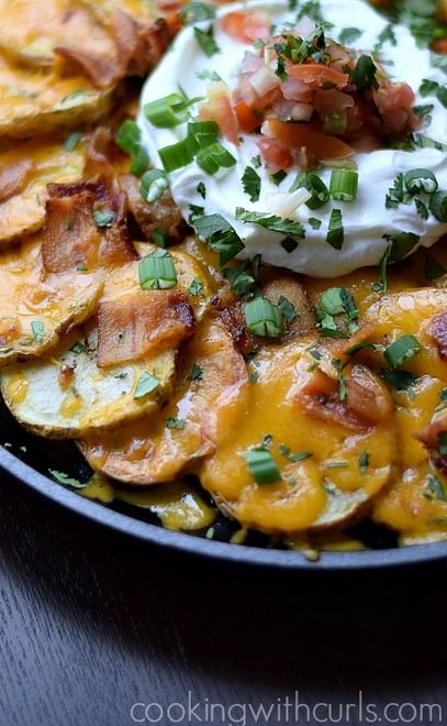 Irish Nachos are just like regular ones, only instead of tortilla chips, potatoes are used as the base.