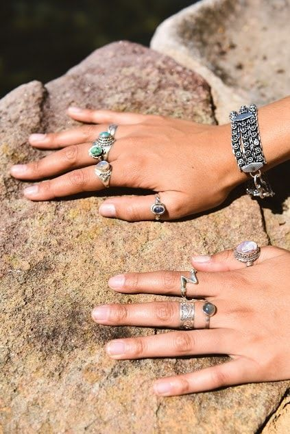 Summer jewelry gypsy look. Moonstone, turquoise, pink moonstone, laborite gemstone rings. sterling silver gemstone rings. Metal patter bracelet Lookbook – The Namaste Boutique