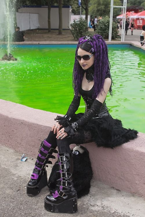 Beside the Toxic pool of DEMF a lovely Cyber Goth sits waiting with her stuffed animal