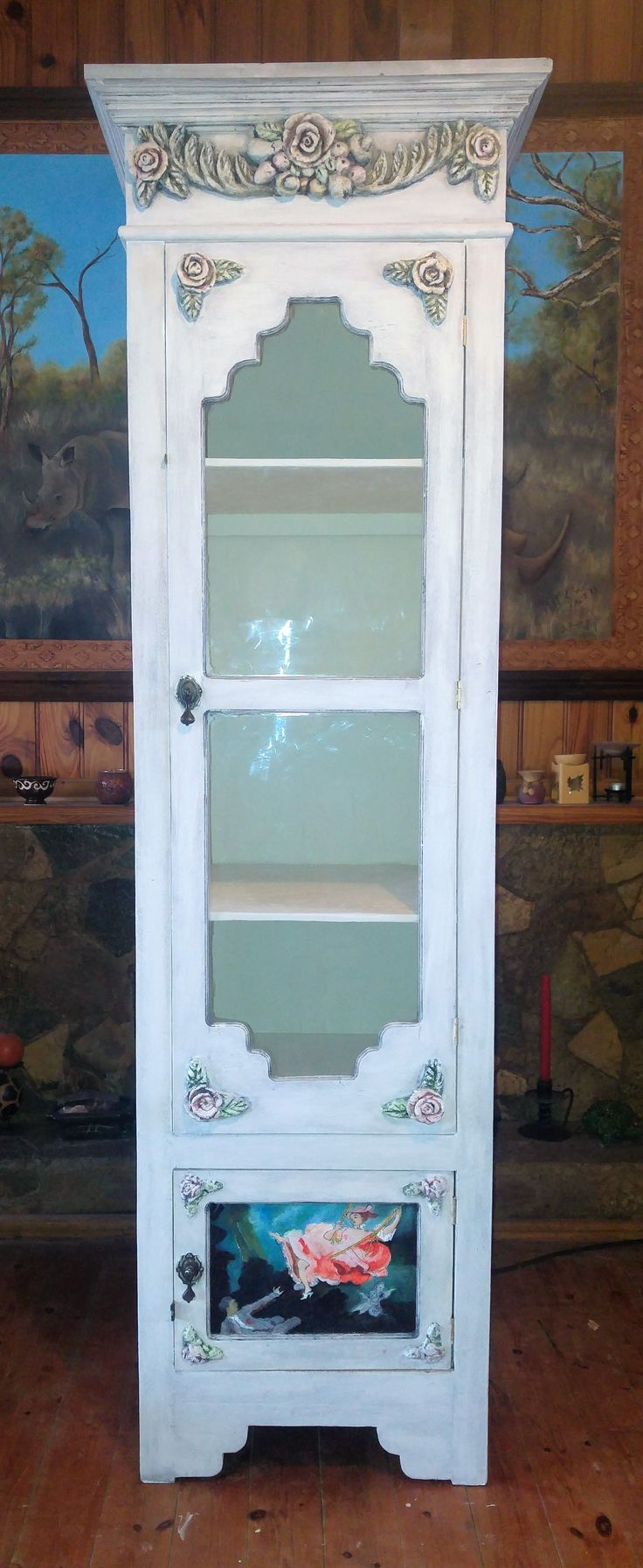 Chimney Armoire  (500 mm x 500 mm x 2000 mm approximately) Price: R6200.00 The beautiful two meter High cupboard will bring elegance to any room. Feature a glass door with 4 shelves above and a little compartment at the bottom. Can be fitted with glass or painted panel to fit you requirements. Painted panels are priced individually. This cupboard will be just as charming in your bathroom and kitchen as it in the lounge or dining room.