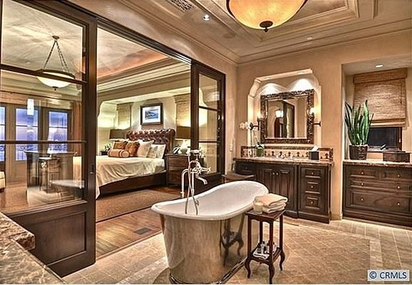 /the-master-bedroom-and-bathroom-reminds-us-of-a-hotel-the-tub-is-beautiful.jpg