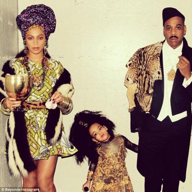 She's his Queen! Beyonce and Jay Z rock Coming To America costumes as they take Blue Ivy t...