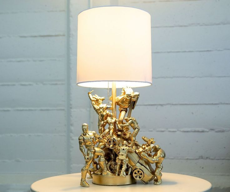I saw a photo of a action figure lamp years ago and immediately fell in love. And then I made about 400 other things and never got around to making it. BUT NO LONGER!Bask in the action figure's lamp gold and action-packed glory. :DThis action figure lamp is a fairly quick and cheap project, and I love that the results are so dramatic with so little effort! Plus, it will be nice to have some geeky things around presented in a nicer fashion. All I've got left as far as action figures are some…