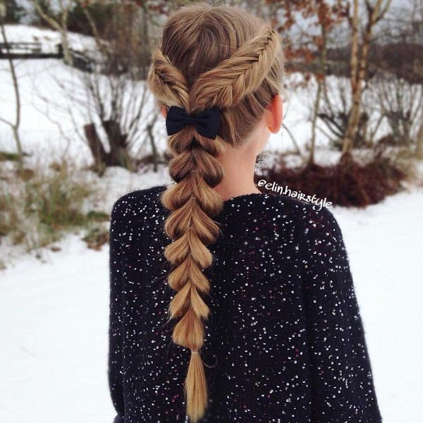 Start with parting your hair in the middle and creating two fishtails. Then tie the remaining in a ponytail and create a pull through braid. Another way to rock two hairstyles in one.