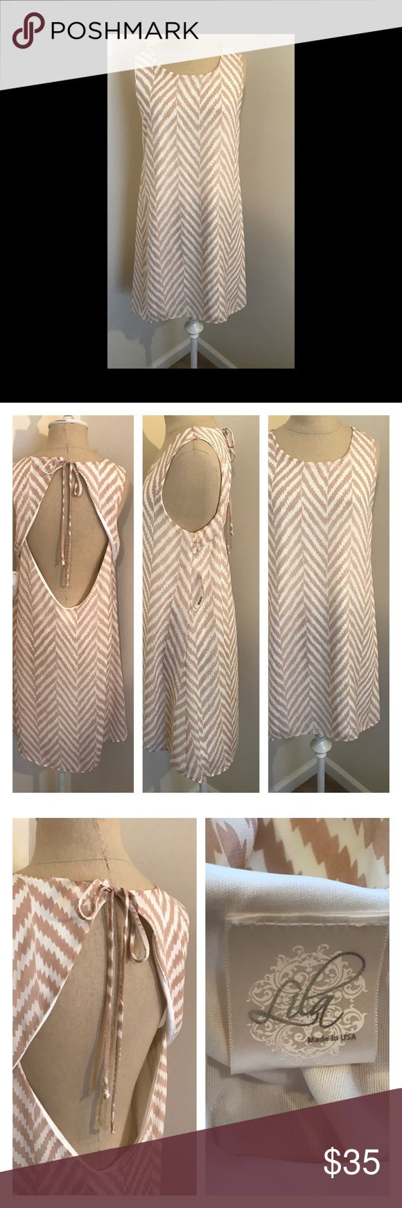 "⭐️New listing⭐️ Lila chevron dress L NWT Gorgeous tan and cream flowing dress by Lila size Large. There is no size tag, but based on measurements I believe this to be a large 8-10. Ties at back of neck and has an open back. Dress is lined. Underarm to underarm 18"", shoulder to hem 32"". No material tag so recommend hand wash. Lila Dresses"