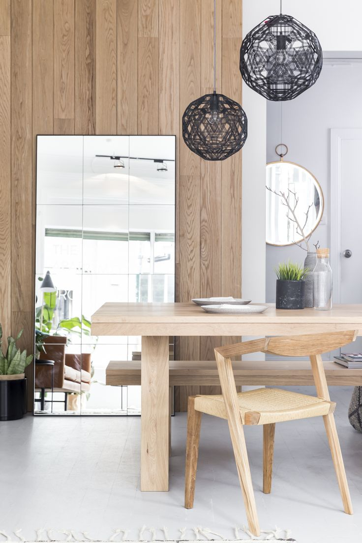 Hanging Zattelite black pendants and the Leaning Loft Mirror provide delicate geometries to the space. Timber accents give softness and warmth.