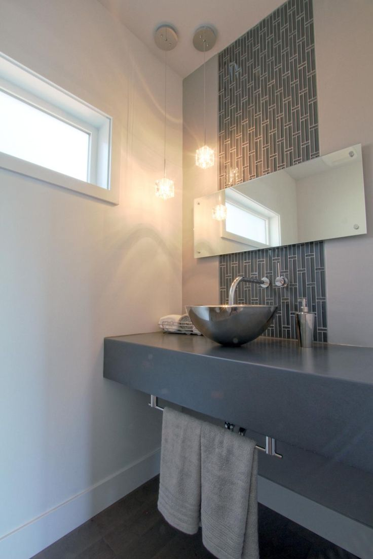 Weave pattern honed in a mesh on unfinished furniture bathroom vanity - A Beautiful Mounted Counter Supports A Stainless Steel Vessel Sink And Towel Rack In This Modern