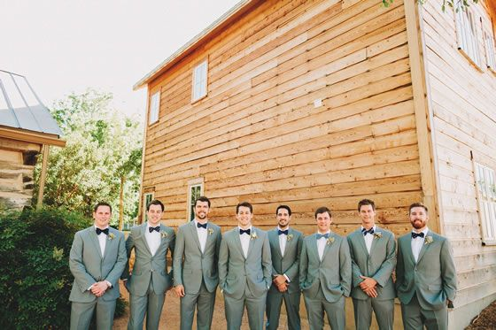 The groomsman sport gray suits, succulent boutonnieres, and navy bow ties with different patterns | Hoffman Haus | Two Pair Photography | Planner: Stratford Events