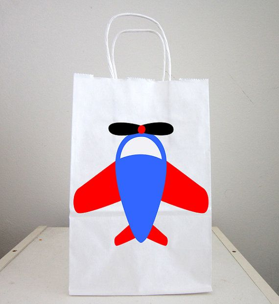 This listing is for (1) airplane party favor/goody/gift bag. These cute airplane bags would be a great addition to your plane party, plane theme event, etc... You can use the bags as favor bags, goody bags or small gift bags.  Purchase Includes:  - (One) Favor/Goody/Gift Bags (Bag is white with handles and is approx. 8.5 tall and 5.5 wide)  Character on bag is made out of a printed image on premium cardstock paper and are on one side of bag. Also, for coordinating items, p...
