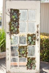 Old door with vertical succulent planters.    Check this out @Kerry Aar Edmonds and @Debbie Arruda Brown Legge!