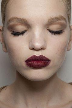 Shadowed eyes and a dark lip - Daphne Groeneveld.