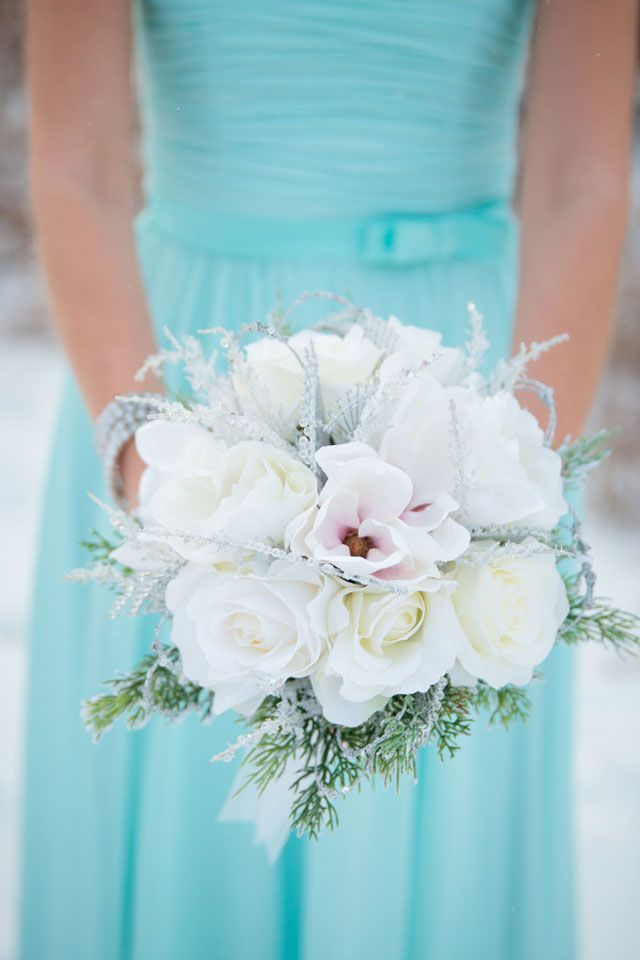 A winter wedding on the first snow fall of the season in a palette of Tiffany blue and silver   Crown Photography: crownphotography.ca