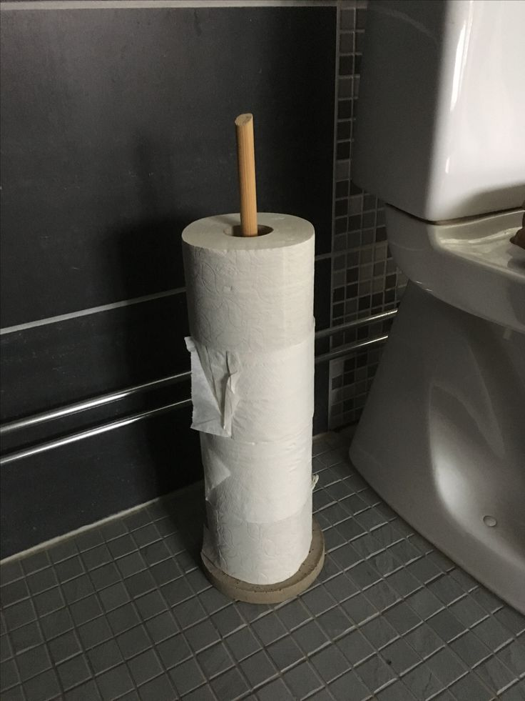 Toilet paper holder of concrete and wood