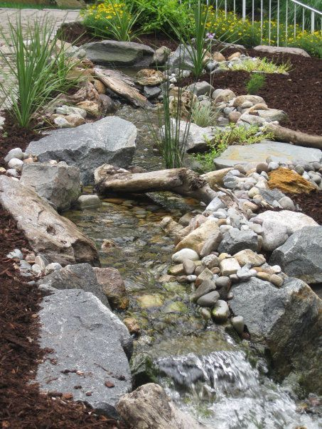 rainwater harvesting and self sustainable water feature, doors, go green, outdoor living, ponds water features, spas, A great shot of the meandering stream thanks to the variation in rock work along the way The excavation was perfectly straight prior to any of our precise rock placements