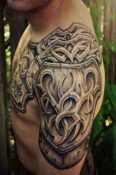 A little like Eden's shoulder armour tattoo, except his has flames coming out of it.