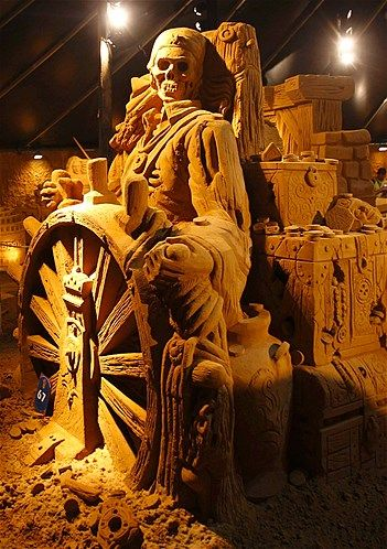 "A sand sculpture representing a scene of Walt Disney movie ""Pirates of the Caribbean"" during the sand sculptures festival in Blankenberge June 28, 2011."