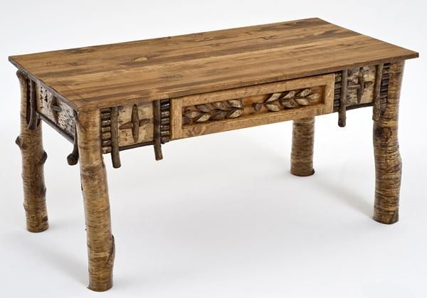 This birch bark artistic coffee table is a work of art. The legs of this table are yellow birch with a light coating of lacquer to seal the bark. The base of the table is decorated with an Adirondack style technique. Thin sliced crosscut birch boughs are arranged to form three dimensional designs of the