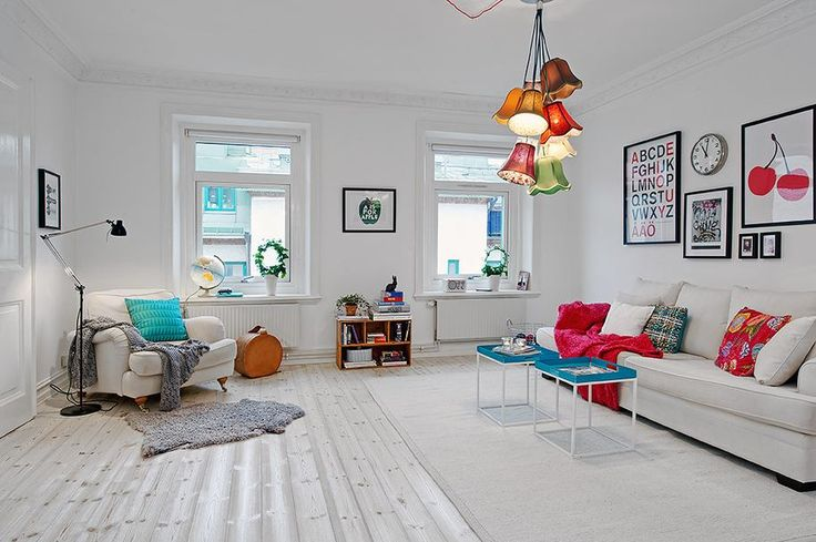 Apartment Interior in Colorful Accent for Unique Design : Scandinavian Apartment Design Living Room Among Minimalist Traditional Sofa Used White Fabric Sofa Also Colorful Pendant Lighting Ideas