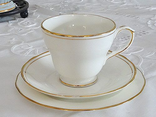 White cup set with gold trim for hire