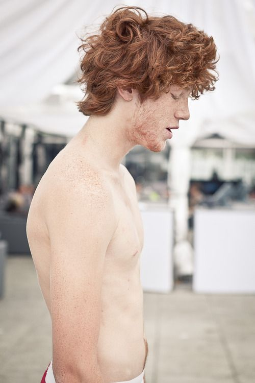 Nude male redhead with freckles