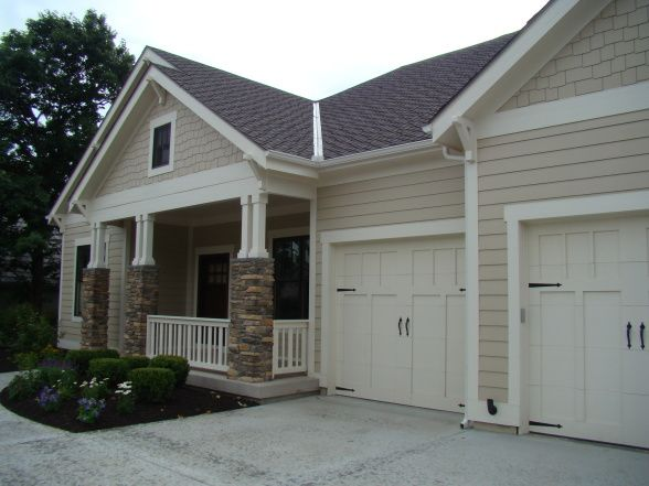 bungalow exterior paint body color is SW 7512 Pavillion Beige and the trim is SW 6098 Pacer White.