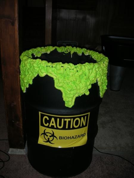 an old 55 gal barrel black paint a caution sticker and spray foam painted diy halloween decorationshalloween - Homemade Halloween Props