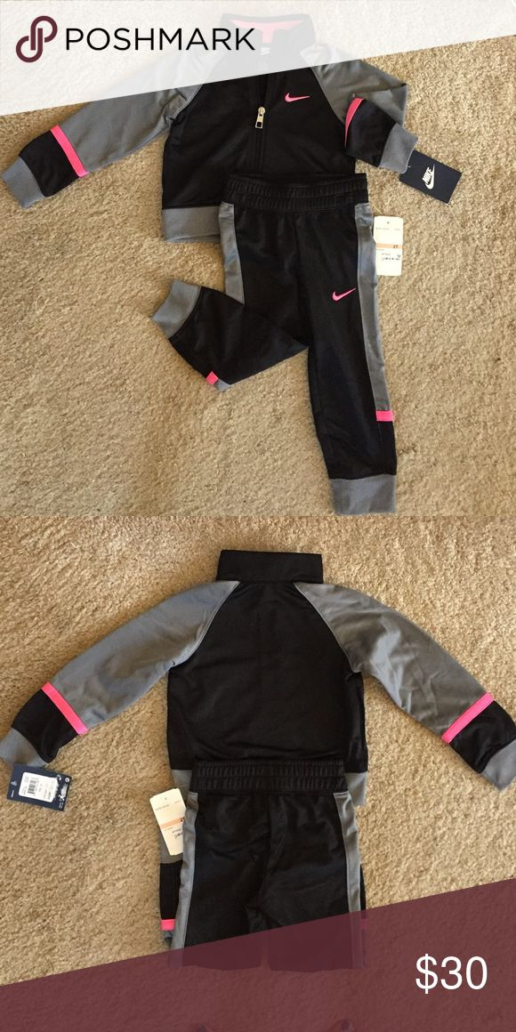 Gorgeous New with tags NIKE Jogging Suit size 2t Gorgeous New with tags NIKE Jogging suit! Zip jacket has Nike swoosh on front in hot pink pants have swoosh on right in hot pink as well! Size 2T Nike Matching Sets