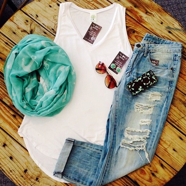 Worn jeans, white breezy tank top, scarf, accessories.