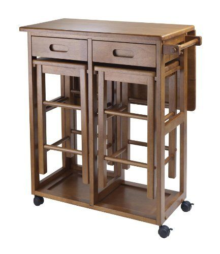 """Space Saver with 2 Stools, Square by Winsome. $186.81. Assembly Required Yes. Width 29.13. Style Transitional. Height 32.76. Length 29.61. On wheels for easy transport, this bar conveniently comes with two stools that can be stored on the cart. There is a square drop leaf table that accommodates two people. Use it in the kitchen or out on the patio for an effortless outdoor meal. Square Stool size 11.40""""W/D x 20.80""""H. Teak Finish. Assembly RequiredColor BrownFinished..."""