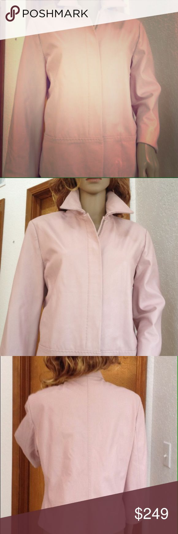 Pink Leather Blazer Jacket by Italian Cerruti 1881 Elegant blazer/jacket with decorative seams, lined in quality pink 100% viscose/rayon, hidden zipper and knobs made of strong metal. Collar nicely emphasizes the neckline. Soft leather in a great condition: in some places has some point size discolorations but it does't take away from the beauty of pink leather. Will age gracefully, Lining has some tiny spots, nothing showy, see pic. Don't  miss out to own timeless Cerruti 1881's creation…
