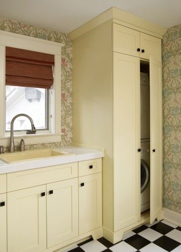 "Peek-a-boo washer and dryer cabinet. Laundry room 45 4"" crown, linen enamel, full overlay shaker style door, and square knobs."