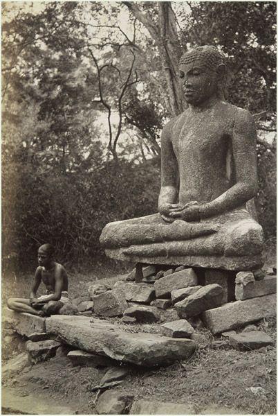 """Boy with Buddha"" was taken by W.L.H. Skeen (1847-1903). It was taken in Anuradhapura, Ceylon (Sri Lanka). It shows a boy meditating along side the Buddha."