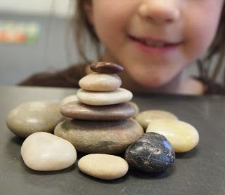 Make Your Own Inuksuk by Mary Wallace. An inuksuk is a balanced based stone sculpture traditionally built by the Inuit. These sculptures were used as hunting and navigation aids, coordination points, message centers, and as spiritual markers. The third grade artists expressed their thoughts and ideas by choosing and arranging rocks, stones, and pebbles; these pieces of earth formed by ancient forces long before our time.