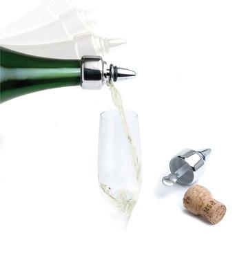 Tapón y cortagotas para Champagne. Su exclusivo sistema de apertura lo convierte una alternativa elegante y original para servir el Champagne sin derramar una sola gota y mantener la botella tapada para evitar la pérdida excesiva de gas. ¡Ideal para la noche de bodas!