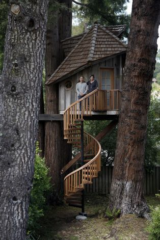 Artist Jay Nelson stands with Daria Joseph in front of the treehouse he built for her on commission in her backyard in Marin County. Photo: Michael Short, The Chronicle