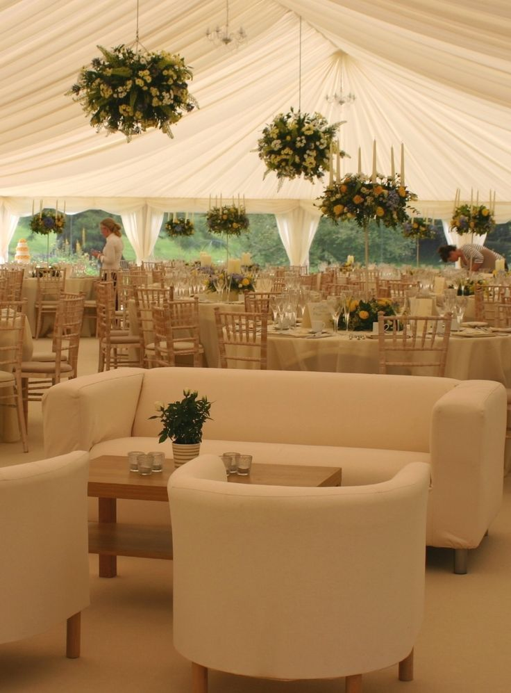 Wedding Tent Stylish Wedding Marquee With Hanging Flower Baskets Dining Tables And Sofas Tent F Marquee Decoration Marquee Wedding Marquee Wedding Decoration