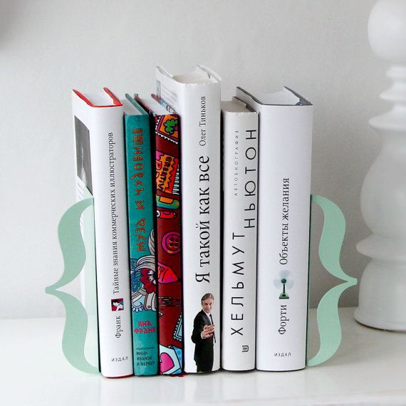 Bookends - Brackets (mint green) - laser cut for precision out of metal thick enough to hold a bunch of books.. €34.00, via Etsy.